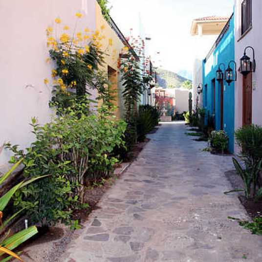 The sidewalk leading to the casa.
