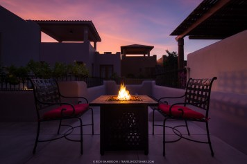 A fire pit table on upstairs patio can keep you warm on cool nights.