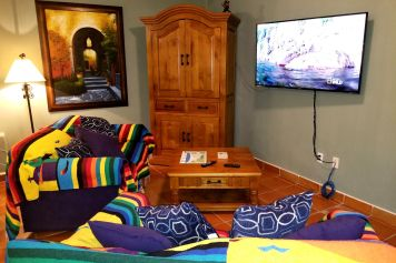 Relax in the living room with your favorite book or watch the satellite TV.