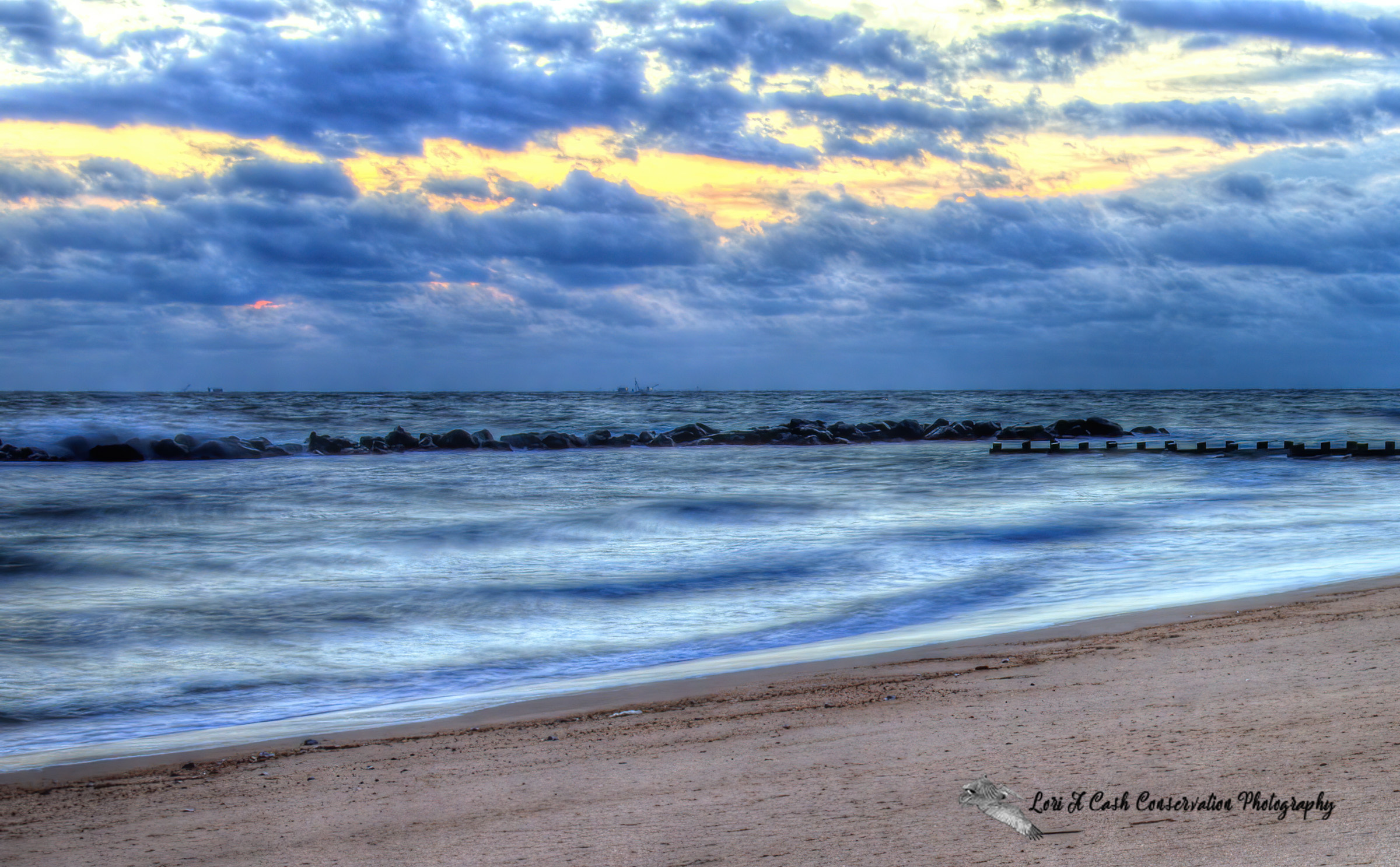 Morning clouds in the blue skies over the beach at Ocean View in Norfolk, Virginia.
