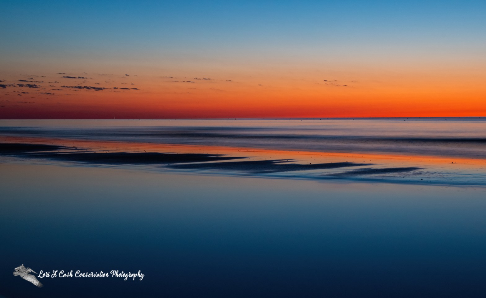 A colorful spring sunrise on the Chesapeake Bay from Fort Monroe National Monument in Hampton, Virginia.