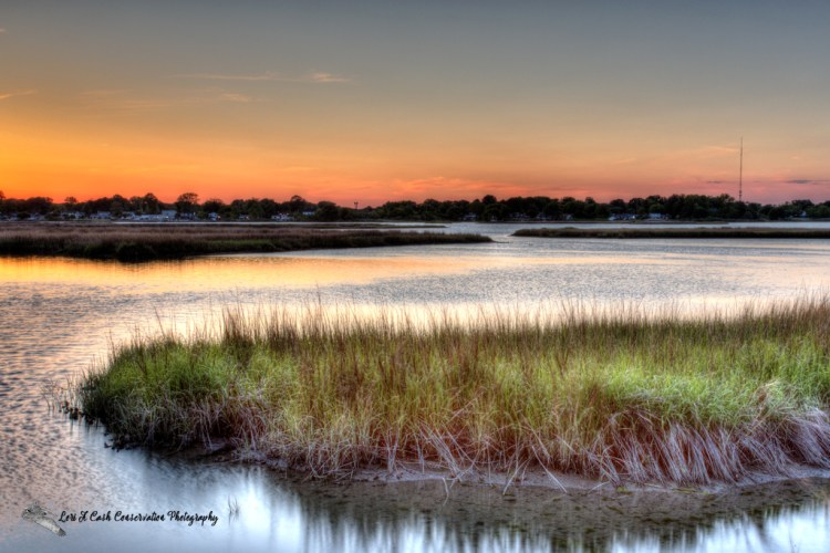 Sunset over the marshes on Mill Creek at Fort Monroe National Monument in Hampton, Virginia.