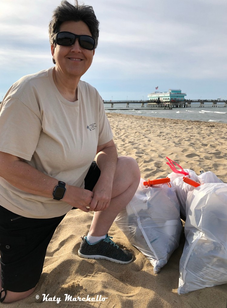 Lori A Cash with bags of litter that she helped pick up as a participant in the Beachside Litter Challenge over Memorial Day weekend with Keep Norfolk Beautiful.