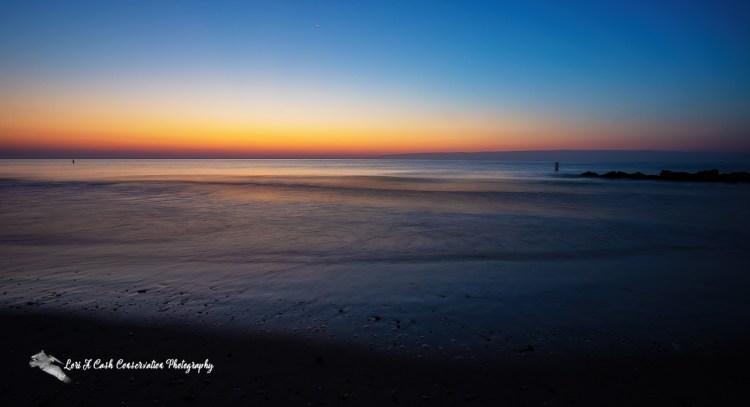Buckroe Beach at twilight on a summer morning in Hampton, Virginia.