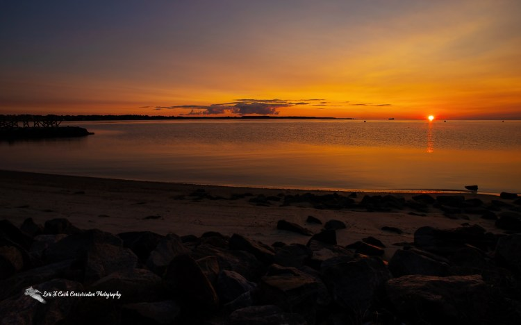 Sunrise on the York River on a summer day from the beach at Yorktown, Virginia.