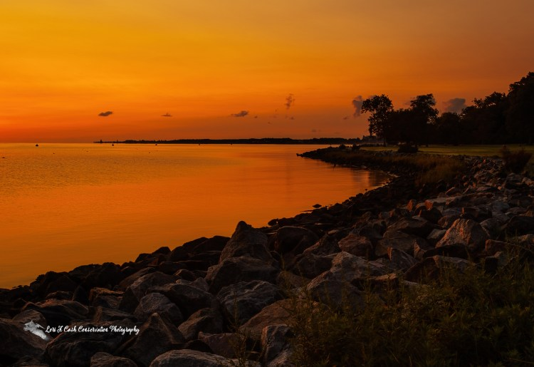The colorful sunrise along the shore of Yorktown and the York River in Virginia.