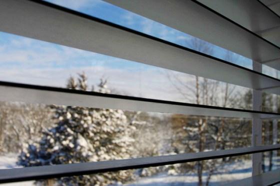 Snow through venetian blinds