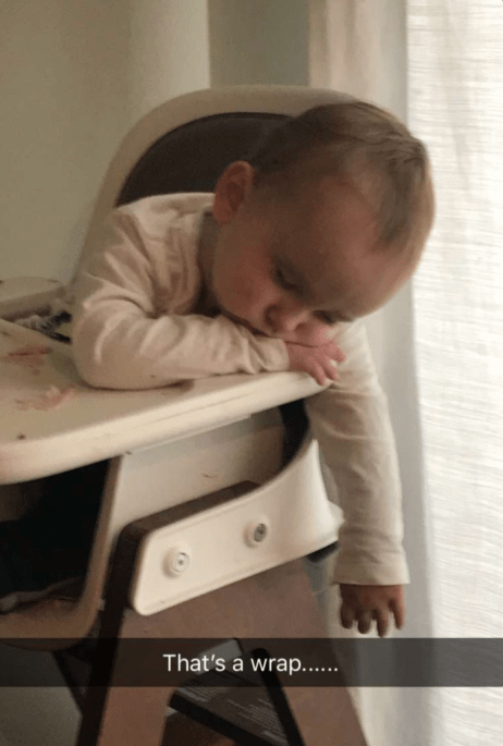 Toddler sleeping in highchair