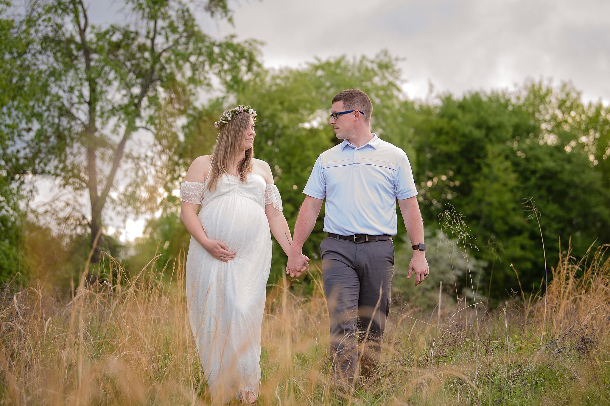 expectant parents holding hands
