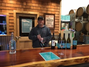 Brendan Malm getting ready to open another bottle of his Malm Cellars wine