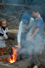 A Few Kids, A Fire, A Handful of Kernels, and an Old Pot
