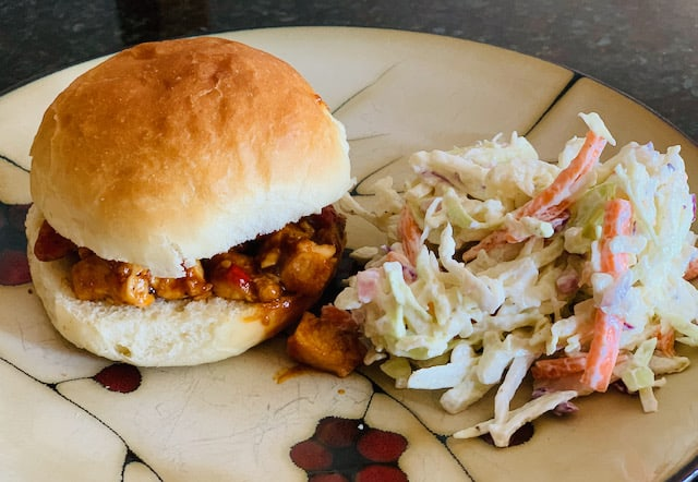 Coleslaw with pulled chicken sandwich