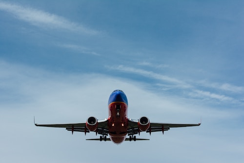 Shot of airplane from underneath. For announcement for an SAP consulting firm.