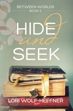 Cover for Between Worlds 5: Hide and Seek, by Lori Wolf-Heffner. Old photo albums stacked on top of one another.