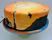 London Skyline on cake, shillouette of couple on bench, london wedding cake, hand painted cake of london, london Eye cake, Big Ben cake, Birds on cake, sunset wedding cake, sunrise wedding cake, Table Mountain, Andes