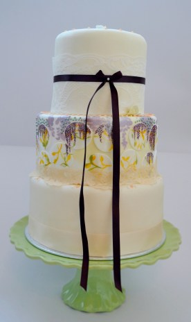 wisteria cake design, yellow and purple wedding cake, painted floral wedding cake, hand painted wedding cake, pastel wedding cake with lace, peach lemon and purple cake, english garden wedding cake,