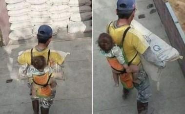 Albañil cargando a su hijo