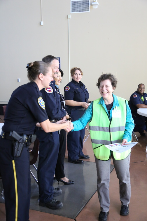 Captain Katie Krauss congratulates Los Altos resident Agnes Caufield (co-leader of BAT 11) on her CERT graduation.