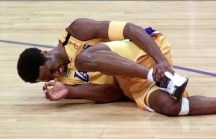 Image courtesy of youtube.com - Bryant lying on the floor, grabbing his left ankle, after suffering a sprained left ankle during the first half of a win in the NBA Finals over the Indiana Pacers