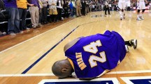Image courtesy of purpleandgoldbold.com - Bryant lying on the floor after suffering a sprained left ankle during a loss to the Atlanta Hawks