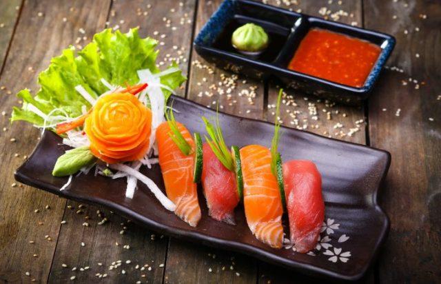 Japanese Salmon, tuna sushi and sauce closeup
