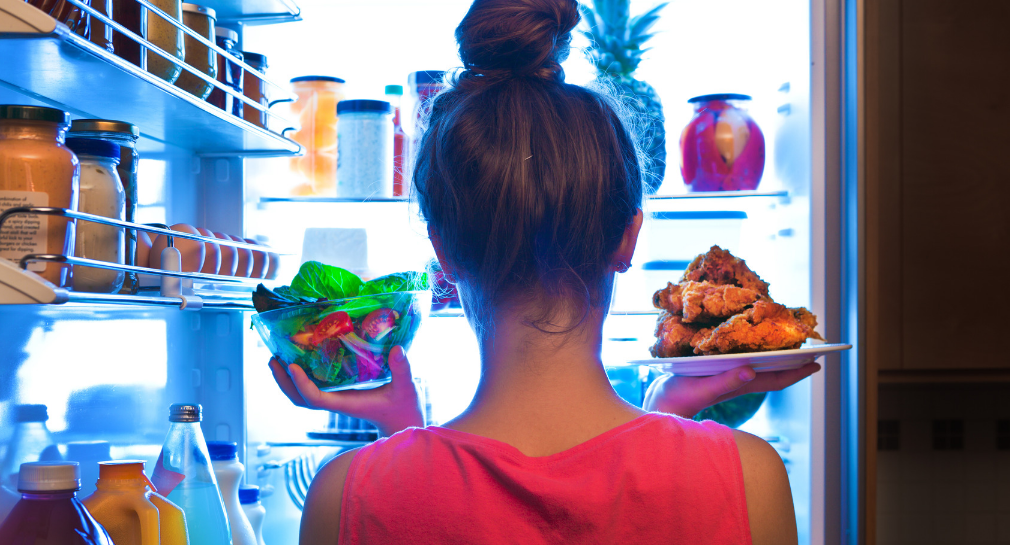 women looking in refridgerator