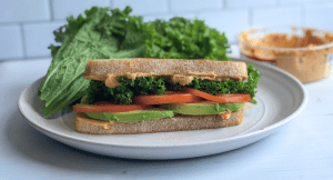 healthy hummus and avocado sandwich on a plate