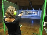 Monica shooting with a light weapon. The position couldn't be more professional