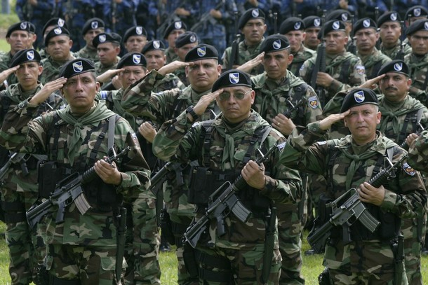 Some of the 200 soldiers of El Salvador's Army from Cuscatlan's 11th Battalion walk in formation during a ceremony in San Juan Opico city