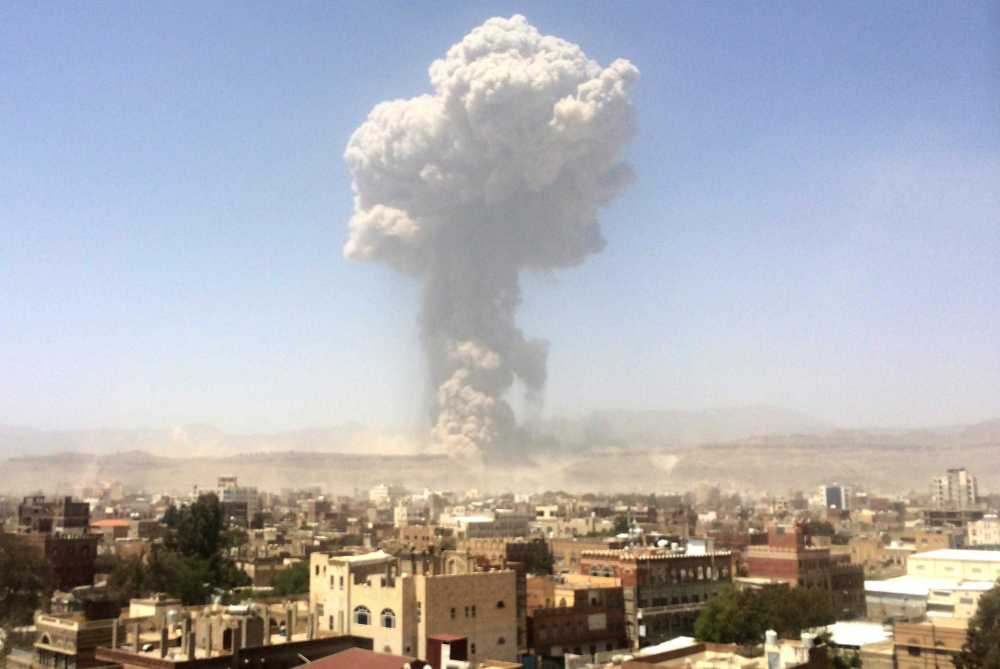 a-plume-of-smoke-rises-after-an-air-strike-in-sanaa-data