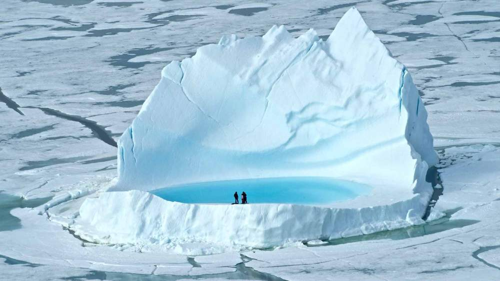 arctic-canada-ak-family-on-iceberg-copyright-maneul-lazcano