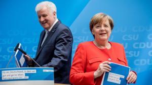 L'accordo sui migranti salva il governo Merkel