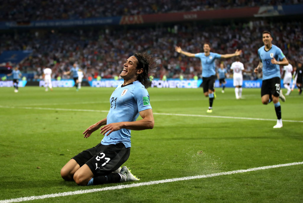 SOCHI, RUSSIA - JUNE 30: Edinson Cavani of Uruguay celebrates after scoring his team's first goal during the 2018 FIFA World Cup Russia Round of 16 match between Uruguay and Portugal at Fisht Stadium on June 30, 2018 in Sochi, Russia. (