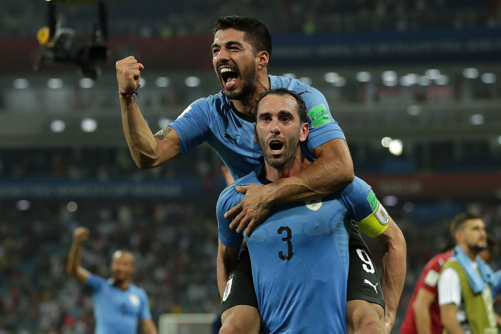 SOCHI, RUSSIA - JUNE 30: Luis Suarez and Diego Godin of Uruguay celebrate victory at the final whistle during the 2018 FIFA World Cup Russia Round of 16 match between Uruguay and Portugal at Fisht Stadium on June 30, 2018 in Sochi, Russia.
