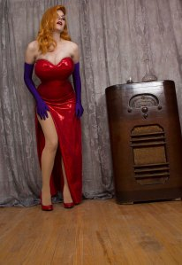 Lossien as Jessica Rabbit, wearing an orange wig, a form fitted red dress, and long purple gloves.