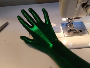 A green gloved hand.