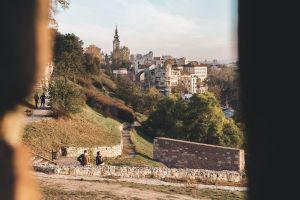 Visit Belgrade Serbia header banner showing Belgrade city from Kalemegdan Park in Autumn.