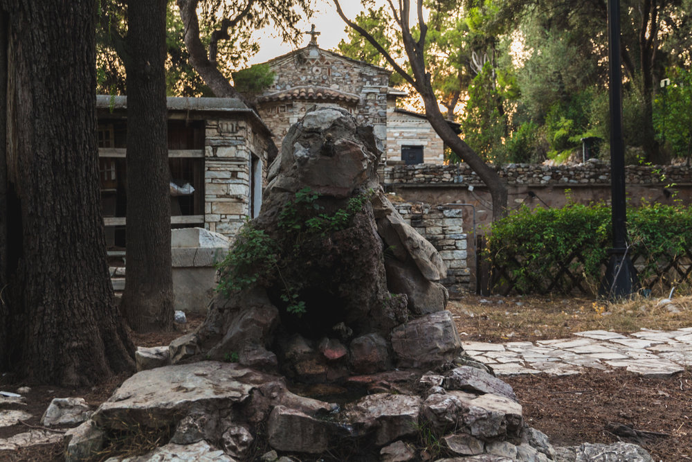 Photo of an ancient fountain on Filopappos Hill near Acropolis in Athens Greece.