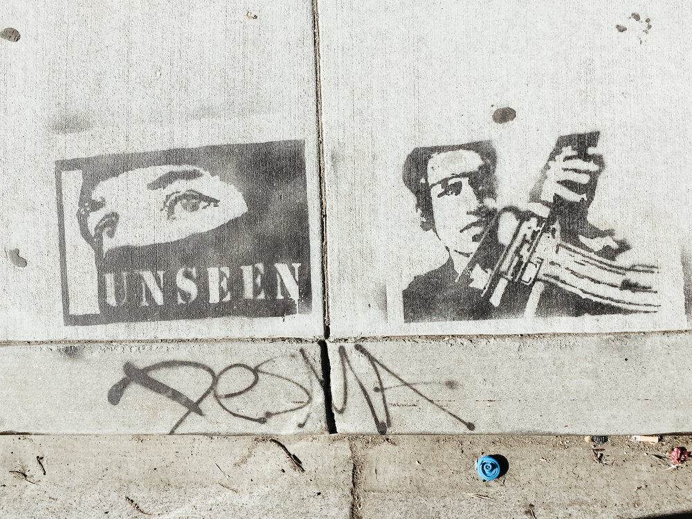 Lost in Los Angeles Photo Series. Photo of graffiti on the sidewalk in Los Angeles.