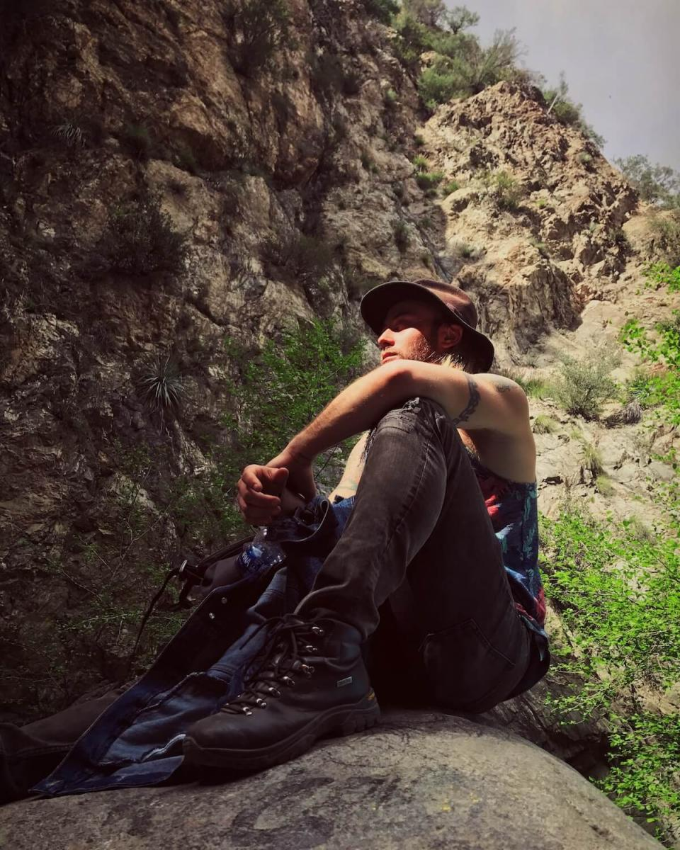 Ryan Brown Lost Boy Memoirs sitting on a rock in Eaton Canyon
