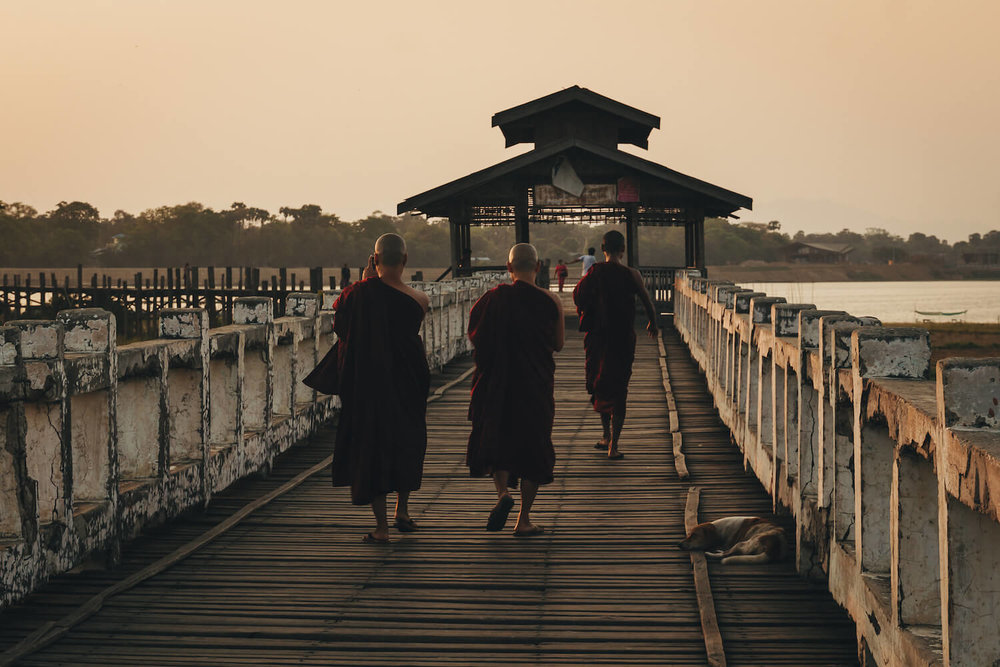 Photo from Ubein Bridge, a Unesco World Heritage site in Myanmar, and the oldest and longest teak wood bridge in the world. Photo from Ubein Bridge, a Unesco World Heritage site in Myanmar, and the oldest and longest teak wood bridge in the world. Monks walk along the bridge across Taungthaman Lake near Amarapura to prayer. #Myanmar #Burma #Travel #Asia #Buddhism