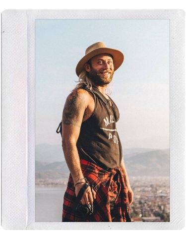 Photo of Ryan Brown of Lost Boy Memoirs travel and adventure blog in a Polaroid frame.