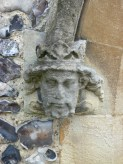 3 - Carved stone head of Edward III beside porch