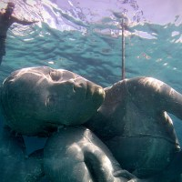 World's Largest Underwater Statue Depicts Woman with Water World on her Back