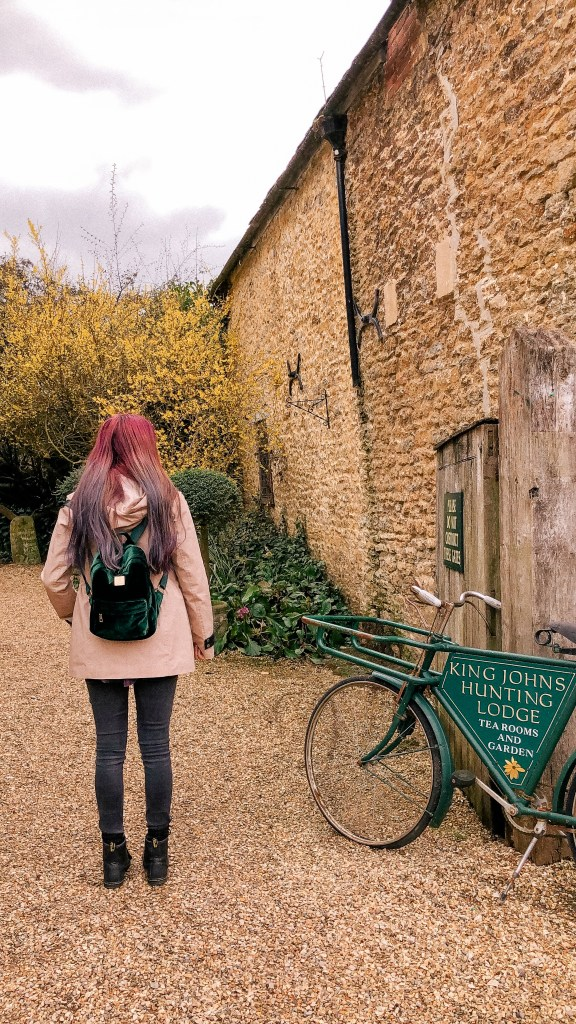 King John's Hunting Lodge, Bike, Pink Hair, Lacock, Wiltshire, Cotswolds, UK, National Trust, England, English Countryside