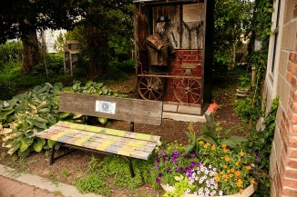 A garden area tucked away along a downtown street in Woodbine, Iowa Friday, June 16, 2017. (photo by Jerry L Mennenga©)