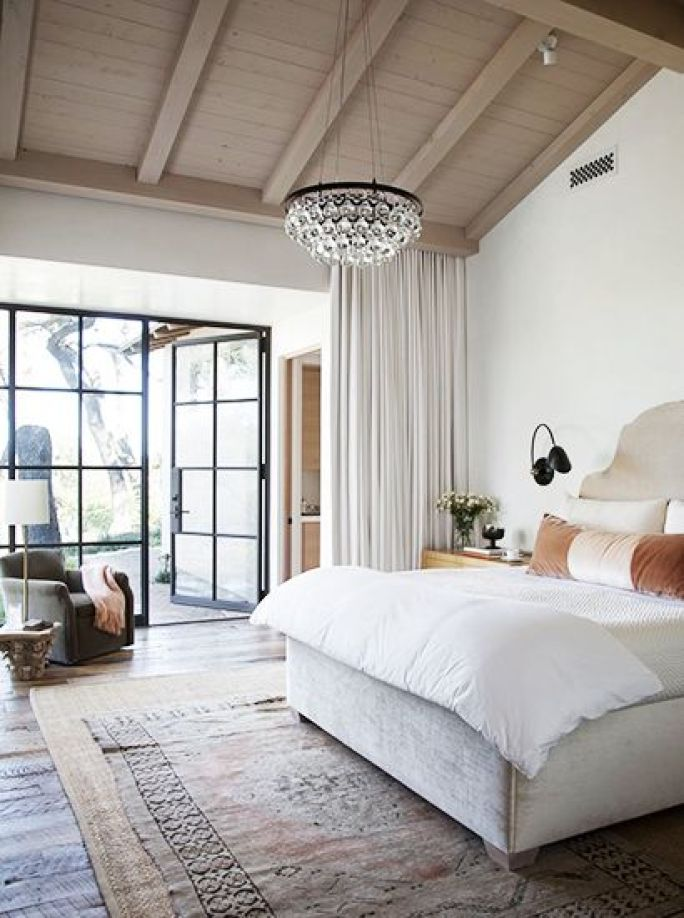Layered Rugs in a Luxe Casual Bedroom