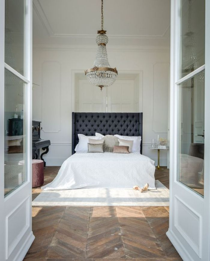 Dreamy Parisian inspired bedroom with a bee of bed rug