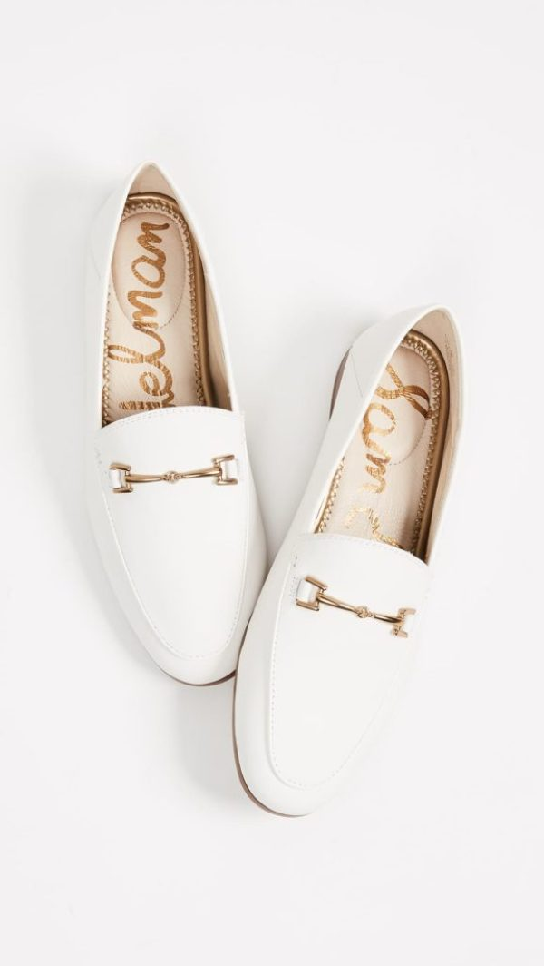 White leather loafers with gold buckle bit
