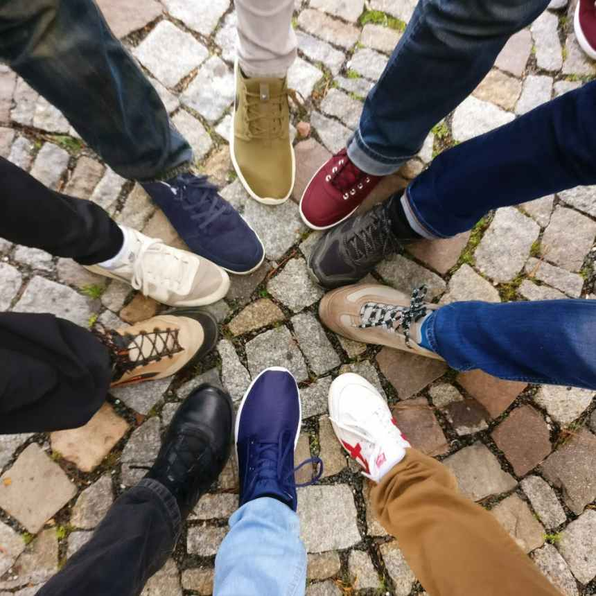 people wearing shoes in community join together